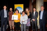 Members of The Latin Collective holding their award certificate.