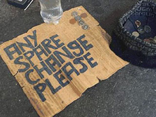 'Any spare change please' sign.