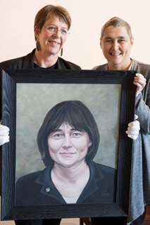 Mayor Celia Wade-Brown presents Helen Kelly with her portrait, to be displayed at the New Zealand Portrait Gallery, Wellington Waterfront.