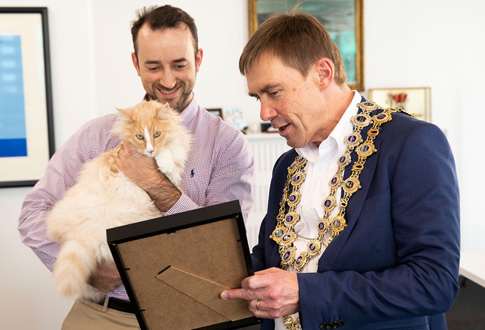 Mittens the cat with Mayor Andy Foster and owner Silvio Bruinsma.