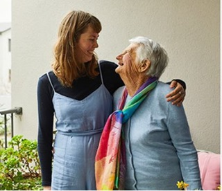 Image of a volunteer and a member of the Aged Concern community