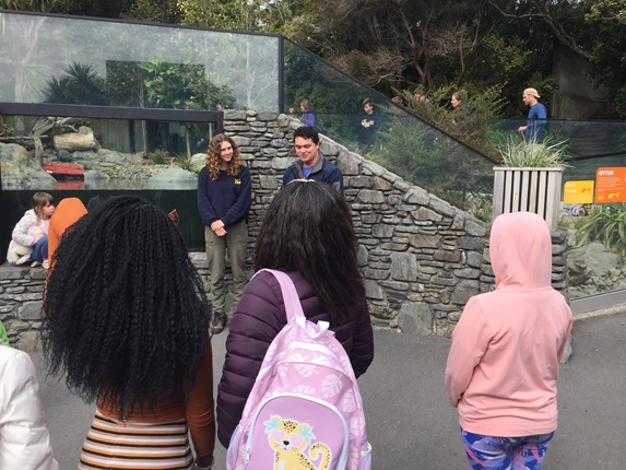 Rangers Anna and Zach welcome a group from ChangeMakers to Wellington Zoo, next to the otter enclosure.