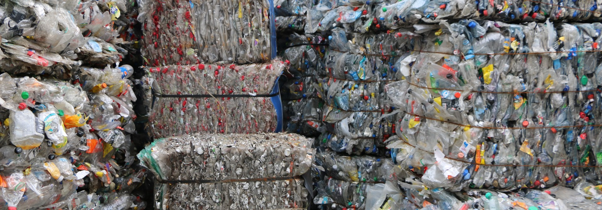Bales of plastic bottles, thousands of them, ready to be sent to a recycling plant.