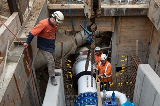 A crew working to install water pipes.