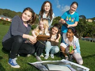 Kids from Johnsonville West School check the plan for their proposed cycle tracks and shed.