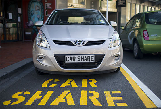 The photo shows a car share vehicle parked in a Wellington car parking space designated for car share vehicles. The word car share is painted on the road surface in large yellow letters.