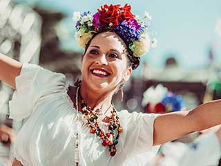 Woman dancing with flowers in her hair.