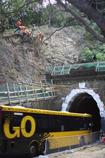 Abseilers installing rock fall netting above Hataitai bus tunnel.
