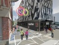 Digital image of what the Holland Street renovation could look like, including pedestrians and colourful additions to buildings.