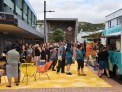 Tawa town centre upgrade opening - people lining up for a food truck.