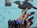 Mayor Justin Lester and others standing in front of the new Mural at the Tawa town centre upgrade opening.