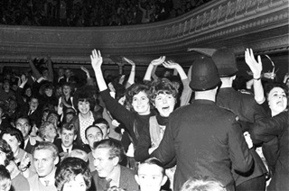 Screaming fans held back by policemen at a Beatles concert at Wellington Town Hall in June, 1964.