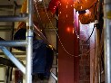 Welders work on steel bracing in Thistle Hall