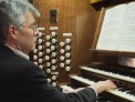 Organist Douglas Mews plays the organ for the last time before it gets dismantled.
