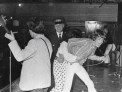 Police restraining a fan who has seized Mick Jagger during a Rolling Stones concert at the Town Hall in 1966.